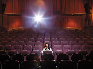 Someone alone in a movie theatre.