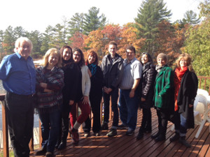 Photos of participants on a wooden deck.