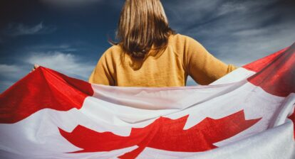 A girl holding the Canadian flag