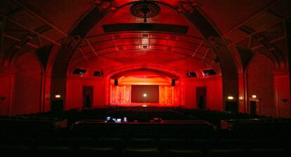 An empty theatre lit up with red lights
